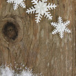 Snowflakes on wood — Stockfoto