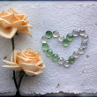 Grunge two Beautiful Yellow Roses Background with a heart from glass beads — Stock Photo