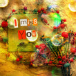 Stockfoto: I Miss You. sentiment spelled out with cut out letters.Card with flowers and beaded necklaces