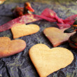 Valentines Day background with heart shaped sugar cookies, old black paper, ducks and red ribbon bow — Stock Photo