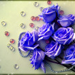 Stock Photo: Blue Roses flowers with pearl bead thread with glass balls