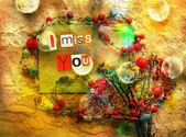 Tęsknię za tobą. sentyment etykietkami z wyciąć letters.card z kwiatami i naszyjnik — Zdjęcie stockowe