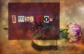 I Miss You. sentiment spelled out with cut out letters. Card with pink carnation flower and Cookie cutter in shape of heart — Stock Photo