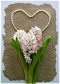 Hyacinth flower with a heart from pearl beads — Foto de Stock