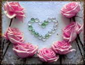 Pink roses and heart from perls — Stock Photo