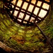 Stock Photo: Pit with grate