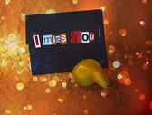 I Miss You. Sentiment spelled out with cut out letters.Card with pear — Zdjęcie stockowe