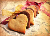 Valentines Day background with heart shaped sugar cookies — Stock Photo