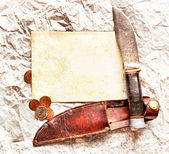 Knife with paper and coins. Grunge background — Stock fotografie