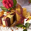 Red Camellia Flower, gift boxes with silk ribbon and bow — Stock Photo