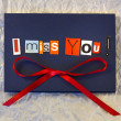 I miss you. Background. Words on blue board — Stock Photo #24506391