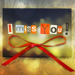 Stock Photo: I miss you. Background with ribbon