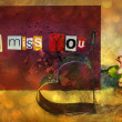 I Miss You. sentiment spelled out with cut out letters. Card with pink carnation flower and Cookie cutter in shape of heart — Foto Stock