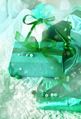 Gift box with green bow — Stock Photo
