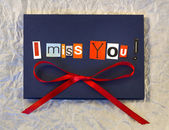I miss you. Background. Words on blue board — Stock Photo