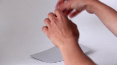 Hands tear apart piece of paper. Torn strip of paper — Stock Video