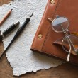 Stock Photo: Busines concept with retro glasses, notebook, ink pen