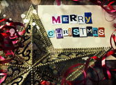 Christmas decorations with greeting card — Stock Photo