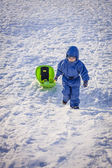 Boy pulling a sledge — Stock Photo