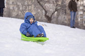 Young boy on sledge — Stock Photo