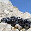 Stock Photo: Car wreck below cliffs