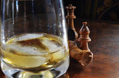 Chess pieces and Whiskey Glass — Stock Photo