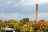 Industrial chimney in the fall — Stock Photo