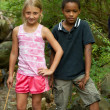 Stock Photo: Boy and girl in stream.