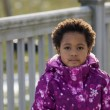 African American girl in front of a fence. — Stock Photo