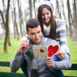 Young love reading a valentine`s day letter — Stock Photo