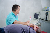 Man gets ultrasound medical examination — Stock Photo
