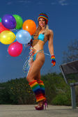 Sexy bikini girl with colorful balloons — Stock Photo