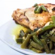Fried chicken leg with french beans on white plate. — Stock Photo #12486033