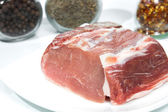 Fresh pork meat on white plate. — Stock Photo