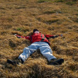 Teenager fell into the thick grass — Stock Photo