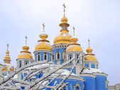 Church domes in the snow — Stock Photo