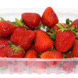 Plastic tray with strawberries. — Stock Photo