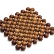 Trivet of juniper beads — Stock Photo #34771583