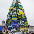 Stock Photo: Frame Christmas tree with flags and placards during protests on