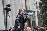 Deputy Pashinsky speaks in the megaphone on meeting — Stock Photo