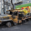 Stock Photo: Burned truck in center of Kiev