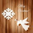 Snowflake and angel on wooden background — Stock Photo