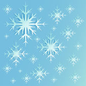 Abstract silver Christmas background with shining snowflakes. — Cтоковый вектор