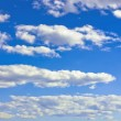 Blue sky with clouds. — Stockvectorbeeld