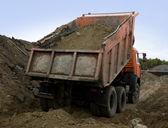 A dump truck is dumping gravel — Stock Photo