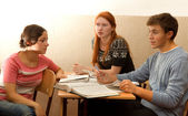 Students discussing in classroom — Stock Photo