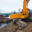 Stock Photo: Excavator builds bridge.
