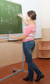 Girl in jeans in physics class — Stock Photo