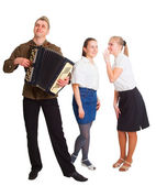 A guy with an accordion and two girls — Stock Photo