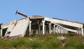 The remains of the destroyed industrial building — Stock Photo
